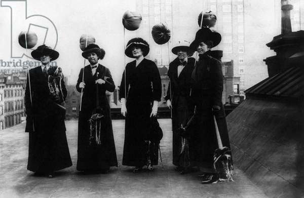 SUFFRAGETTES, 1912 Suffragettes holding lanterns on a rooftop in New York City, prepared to march at night, 9 November 1912.
