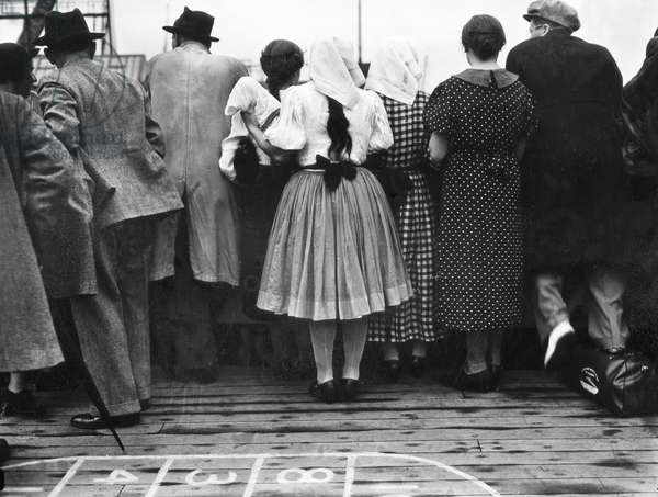 IMMIGRATION, 1937 Men and women aboard the S.S. Aquitania en route to Ellis Island. Photograph, 1937.