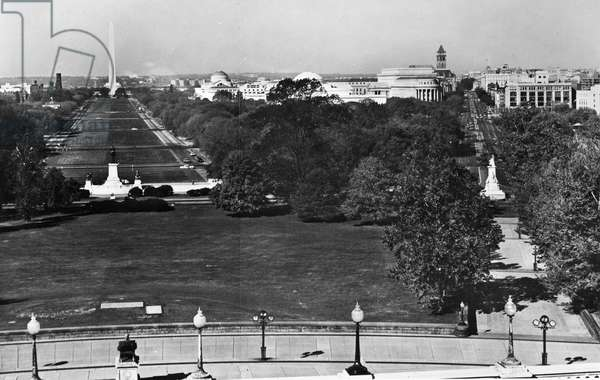 WASHINGTON: NATIONAL MALL A view from the U.S. Capitol in Washington, D.C., looking towards the National Mall and the Washington Monument (left), and up Pennsylvania Avenue Northwest (right). Photographed by William Edmund Barrett, c.1965.