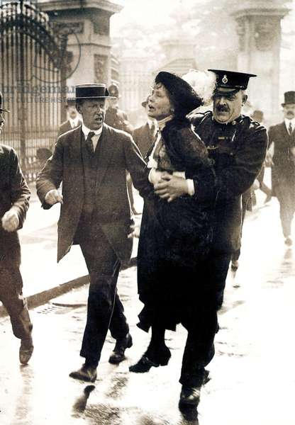 EMMELINE PANKHURST (1858-1928). English woman-suffrage advocate. Mrs. Pankhurst arrested outside Buckingham Palace, London, while trying to present a petition to King George V, 21 May 1914.