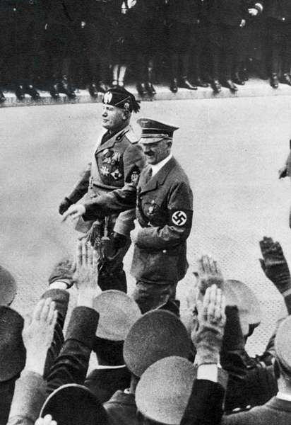 ADOLF HITLER (1889-1945) Chancellor of Germany, 1933-45. Hitler with Italian Prime Minister Benito Mussolini during the latter's state visit to Berlin, September 1937.