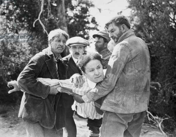 HARRY HOUDINI (1874-1926) American magician. Houdini is forcibly detained in a scene from 'The Grim Game,' 1919.