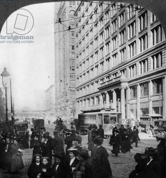 CHICAGO: STATE STREET Marshall Field's & Company department store and the Masonic Temple on State and Randolph streets, Chicago. Stereograph, c.1909.