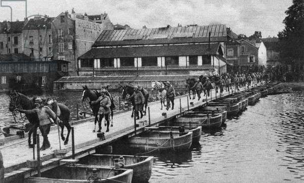 WORLD WAR I: PONTOON BRIDGE French cavalrymen leading their horses over a pontoon bridge in pursuit of the retreating German army after the First or Second Battle of the Marne, 1914 or 1918. Photograph.