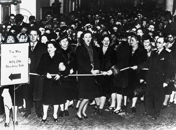 NEW YORK: NYLON SALE, 1940 A crowd of shoppers waiting to buy nylon stockings in New York City, on the day the first nylon stockings went on sale nationwide. Photograph, 15 May 1940.