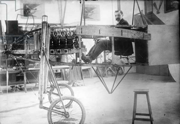 LOUIS BLERIOT (1872-1936) French engineer and pioneer aviator. Bleriot in his workshop, 14 July 1909.