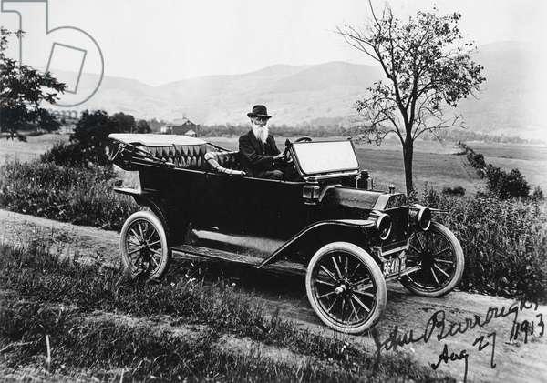 JOHN BURROUGHS (1837-1921) American naturalist. Burroughs in his Model T Ford, c.1913.