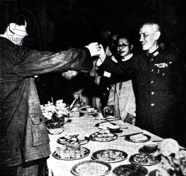 CHIANG KAI-SHEK & MAO, 1945 Communist Chinese leader Mao Tse Tung, left, and Chinese General Chiang Kai-Shek toast one another during a ceremony in Chungking, celebrating the end of WWII following the surrender of Japan, September 1945.