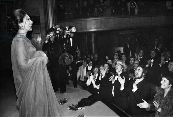 MARIA CALLAS (1923-1977) American operatic soprano. Callas greeting fans after a recital at the Champs-Élysées Theater in Paris, 1973.