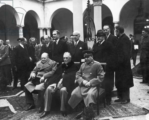 YALTA CONFERENCE, 1945 Allied leaders photographed at the Livadia Palace at Yalta, Crimea, during the Yalta Conference, February 1945. Seated from left: British Prime Minister Winston Churchill, U.S. President Franlin Roosevelt, and Soviet Premier Joseph Stalin.