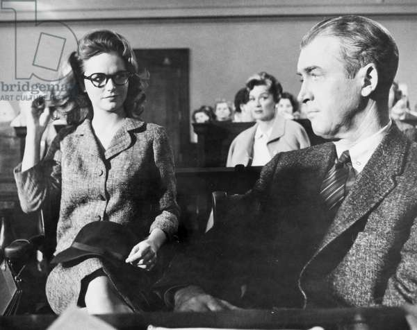JAMES STEWART (1908-1997) American actor. With Lee Remick (and Eve Arden, center background) in the 1959 film 'Anatomy of a Murder.'