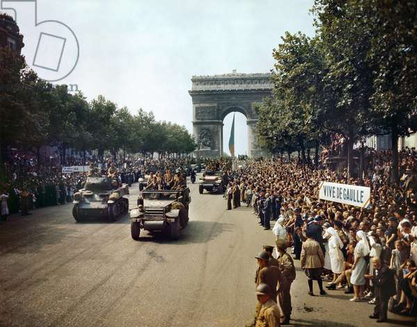 WORLD WAR II: PARIS, 1944 Crowds of French patriots lining the Champs Elysees to view Allied tanks and half tracks pass by the Arc du Triomphe, after Paris was liberated on 26 August 1944. Photographed by Jack Downey.