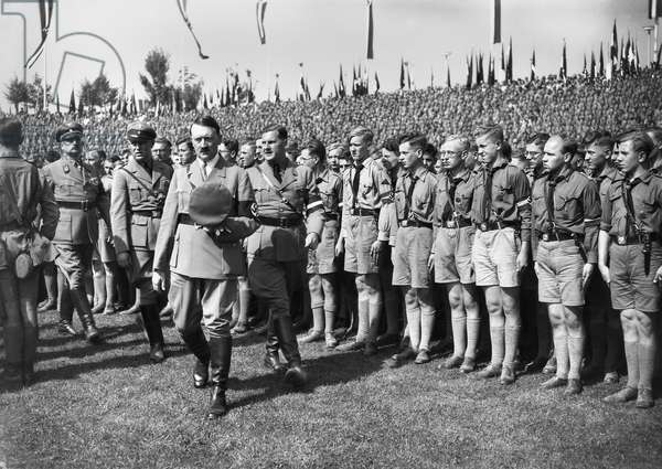 ADOLF HITLER (1889-1945) Chancellor of Germany, 1933-45. Adolf Hitler inspecting the Hitler Youth at a Nazi party rally, 1934.