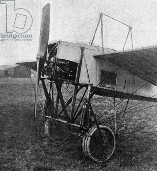 BLERIOT MONOPLANE, 1911 Front view of a Bleriot military monoplane with triple wheels and a glass window. Photograph, 1911.