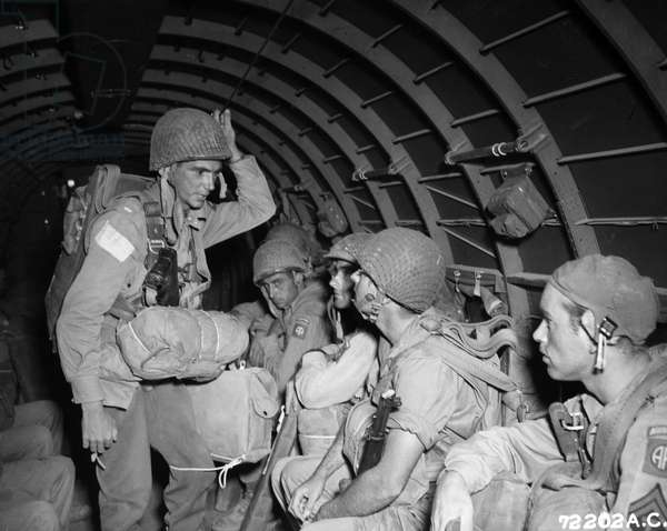 WWII: PARATROOPERS, 1943 American paratroopers of the 82nd Airborne Division prepare for the invasion of Salerno, Italy, September 1943.
