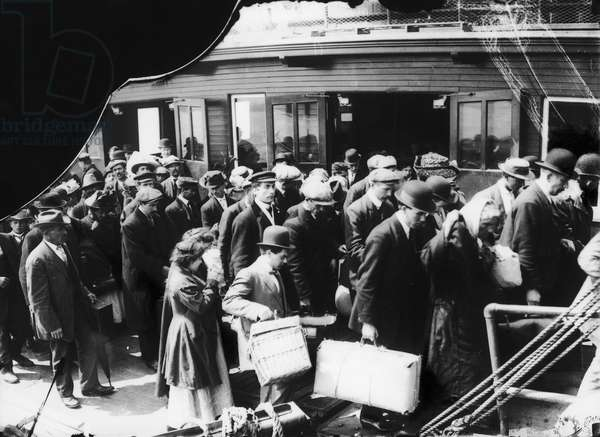 ELLIS ISLAND, 1914 European immigrants to the United States arriving at Ellis Island by ferry. Photograph, 1914.