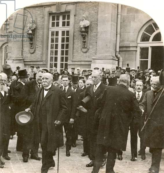 VERSAILLES TREATY. Paris Peace Conference of 1919. Premier Georges Clemenceau, President Woodrow Wilson, and Prime Minister David Lloyd George leaving the Palace of Versailles after the signing of the Peace Treaty, 28 June 1919.