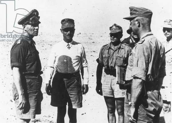 ERWIN J.E. ROMMEL (1891-1944) German general. Rommel at the left with Major the Rev. Bach at the center. Photographed in North Africa in 1942.