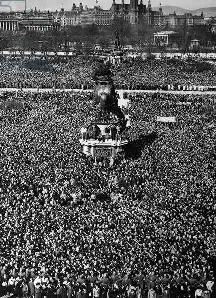 VIENNA: ANSCHLUSS, 1938 Enthusiastic crowds gather to greet Chancellor Adolf Hitler in Vienna, after the German annexation of Austria, 1938. Photograph by Heinrich Hoffmann.