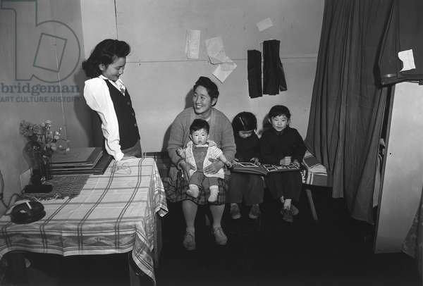 JAPANESE INTERNMENT, 1943 The Nakai family in their home at the Manzanar Relocation Center for Japanese Americans, near Owens Valley, California. Photograph by Ansel Adams, 1943.