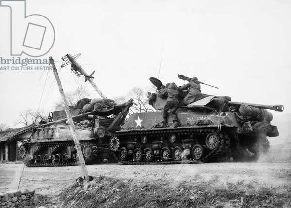 KOREAN WAR: RETREAT, 1950 American troops in retreat just north of Kunu-ri, North Korea, December 1950.