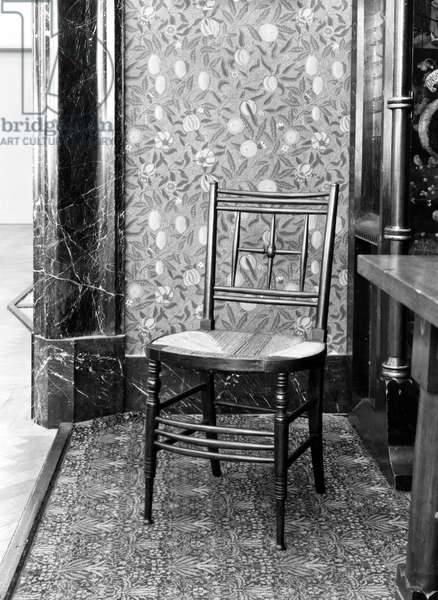 WILLIAM MORRIS DESIGNS Chair and wallpaper designed by William Morris, 1870s.
