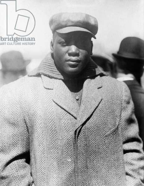 JACK JOHNSON (1878-1946) American heavyweight pugilist. Photographed c.1910-1915.