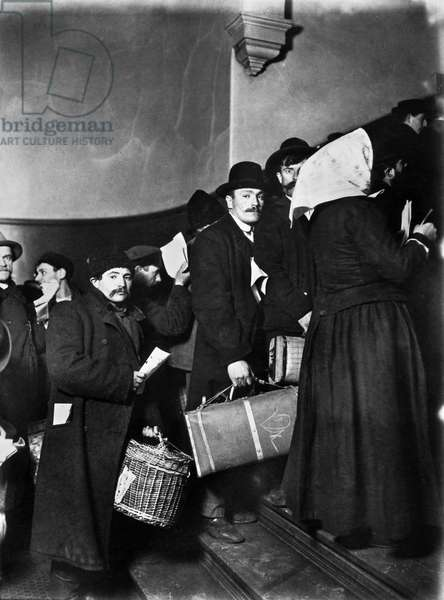 ELLIS ISLAND: IMMIGRANTS A group of Slavic immigrants waiting to enter Ellis Island. Photograph by Lewis Hine, 1905.