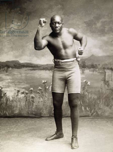 JACK JOHNSON (1878-1946) American boxer. Photographed in 1910.