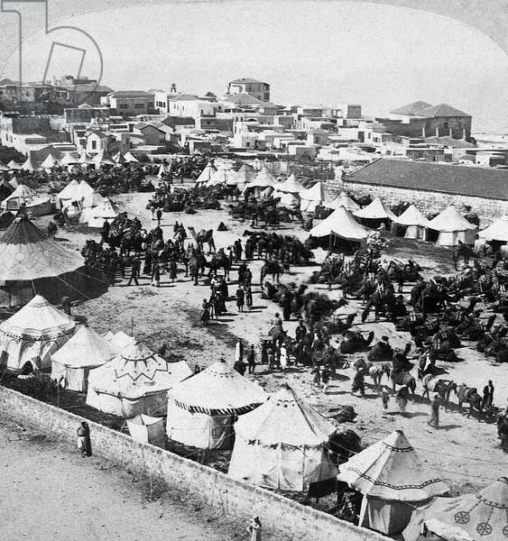 MECCA: PILGRIMAGE, c.1900 A caravan of Persian pilgrims on the way to Mecca, Saudi Arabia. Stereograph, c.1900.
