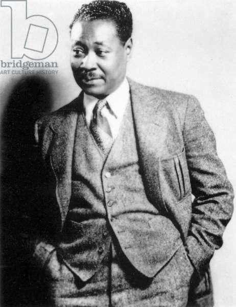 CLAUDE MCKAY (1890-1948) American (Jamaican-born) writer. Photograph, c.1930, by James Latimer Allen.