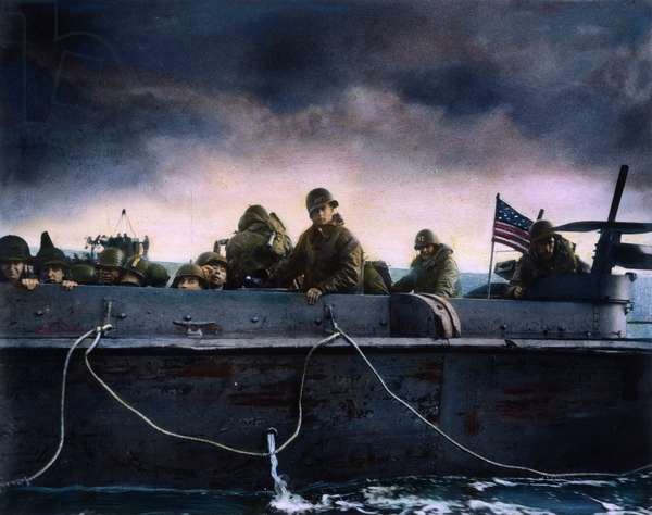 WORLD WAR II: D-DAY, 1944 Soldiers on an American Coast Guard landing barge heading towards a Normandy beach on D-Day, 6 June 1944. Oil over a photograph.