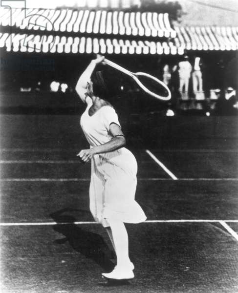 SUZANNE LENGLEN (1899-1938) French tennis player. Photographed, 1920, wearing the midcalf dress that shocked the spectators.
