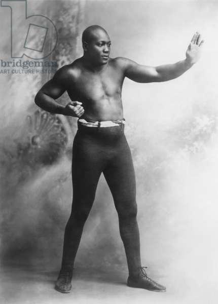 JACK JOHNSON (1878-1946). American heavyweight pugilist. Photographed in 1909.