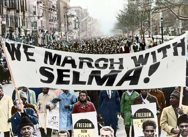 CIVIL RIGHTS MARCH, 1965 Marchers in Harlem, New York City, carrying banners in support of the Selma to Montgomery marchers. Photograph by Stanley Wolfson, 1965, digitally coloured  by Granger, NYC