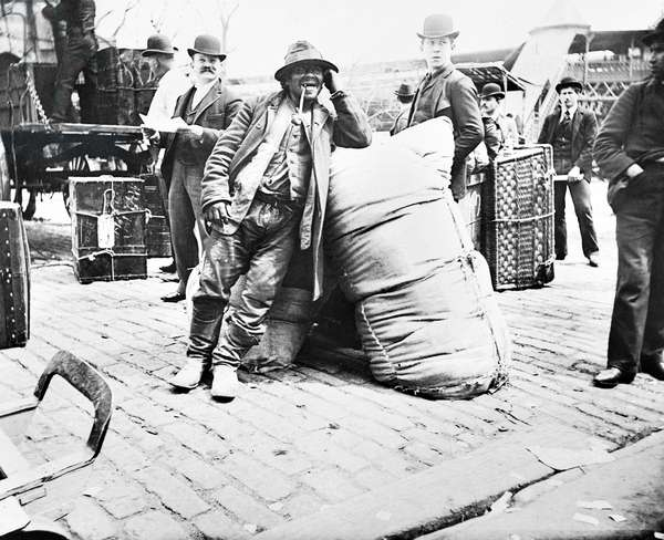 NEW YORK: IMMIGRANTS, 1896 A European immigrant leaning against a large sack upon arrival at Ellis Island. Photographed by Alice Austen, 1896.