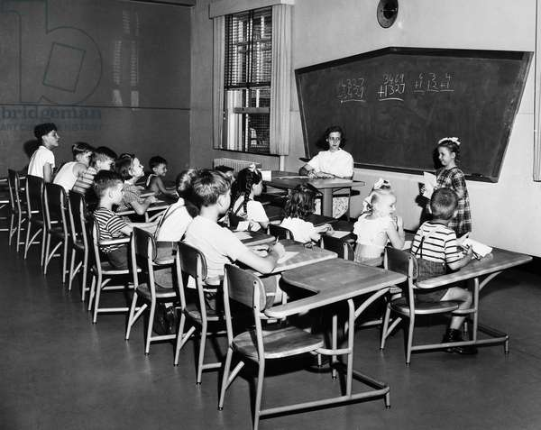 ELLIS ISLAND: SCHOOL, 1951 Children of detained immigrants in a classroom at Ellis Island, New York City. Photograph, 1951.