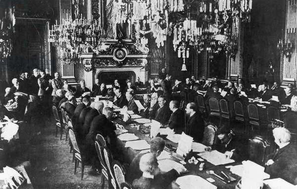 WWI: TREATY NEGOTIATIONS Meeting at the French Ministry of Foreign Affairs at Quai D'Orsay, Paris. Under clock are American and French presidents Woodrow Wilson and Raymond Poincaré. Next to Wilson is Robert Lansing. Also seated: Edward House, David Lloyd George, Arthur Balfour, Andrew Bonar Law. At left: Georges Clemenceau, Stépen Pichon, Ferdinand Foch.