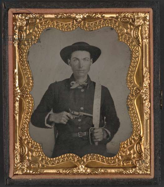 CIVIL WAR: SOLDIER, c.1863 Portrait of a Confederate soldier holding a Baby Colt Dragoon revolver and Bowie knife. Ambrotype, c.1863.