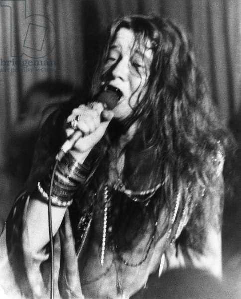 JANIS JOPLIN (1943-1970) American rock singer. Photographed at a concert, 1969.