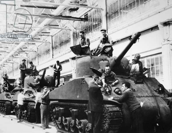 WWII: MUNITIONS PLANT, 1942 Mechanics working on M-4 tanks at a Ford Motor Company munitions plant. Photograph, 1942.