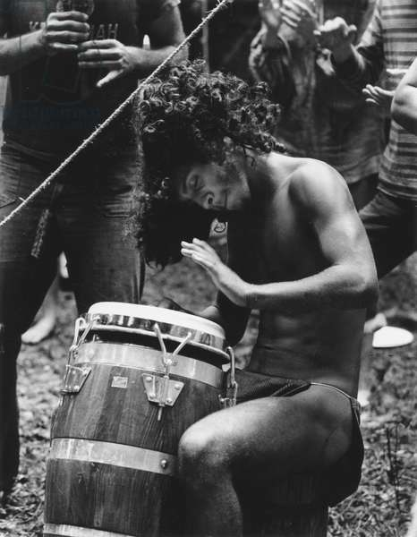 HIPPIE MOVEMENT, 1969 A hippie plays a drum with other musicians at the Woodstock festival.