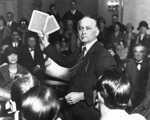 HARRY HOUDINI (1874-1926) American magician. Houdini appearing before a Senate committee to expose fake spiritualists, 1926.