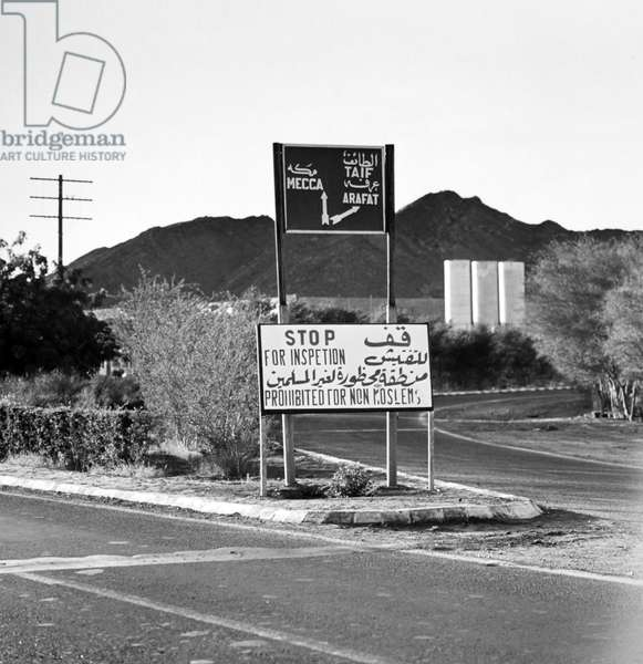 SAUDI ARABIA: MECCA Road sign near Mecca reminding travelers that non-Muslims are prohibited from entering the city. Photograph, 1970s.