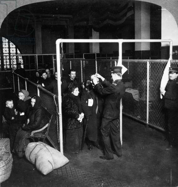 ELLIS ISLAND, 1913 Federal inspectors examining the eyes of immigrants, 1913.