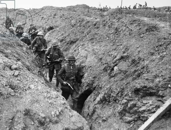 BATTLE OF THE SOMME, 1916 Allied troops walking through a captured trench during the Battle of the Somme during World War I, 1916.