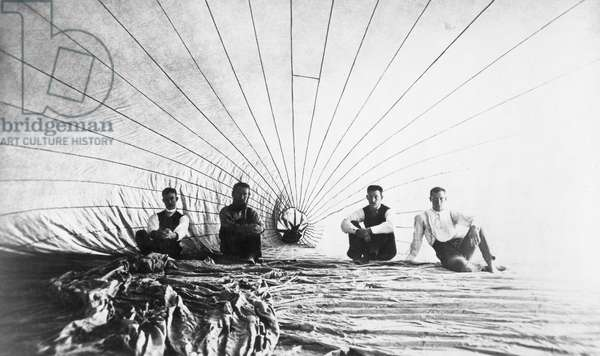 DOUGHTY & MOORE, 1886 American aeronauts John G. Doughty and Alfred E. Moore photographed with two assistants inside their hot air balloon before a flight over Connecticut, 1886.