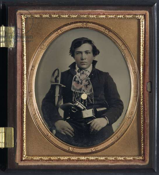 CIVIL WAR: SOLDIER, c.1863 Portrait of a Confederate soldier with a cavalry sword and revolver. Ambrotype, c.1863.