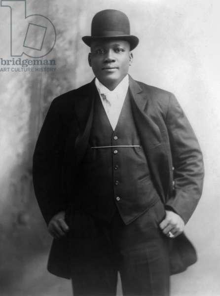 JACK JOHNSON (1878-1946) American heavyweight pugilist. Photograph, c.1909.