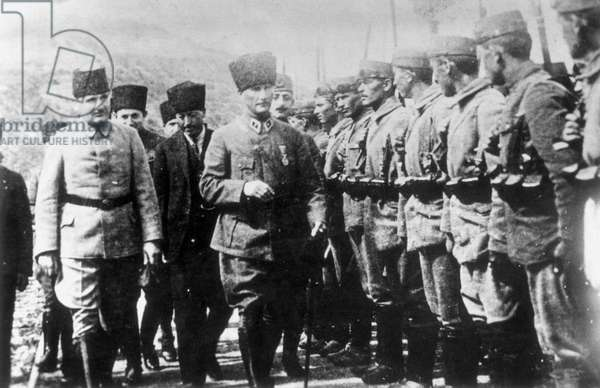MUSTAFA KEMAL ATATURK (1881-1938). Turkish soldier and statesman reviewing his troops.